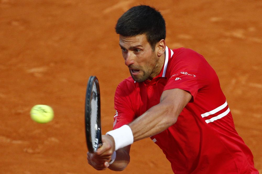 Serbia's Novak Djokovic in action during his semi final match against Italy's Lorenzo Sonego at the Italian Open in Rome May 15, 2021. — Reuters pic