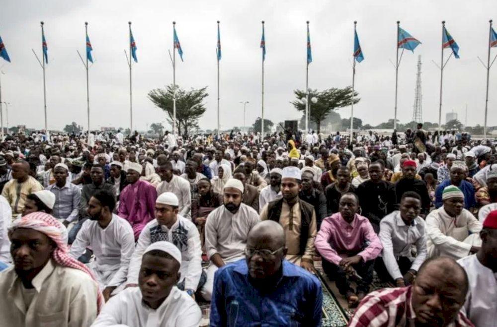 Muslim worshippers at the stadium in Kinshasa. — AFP pic