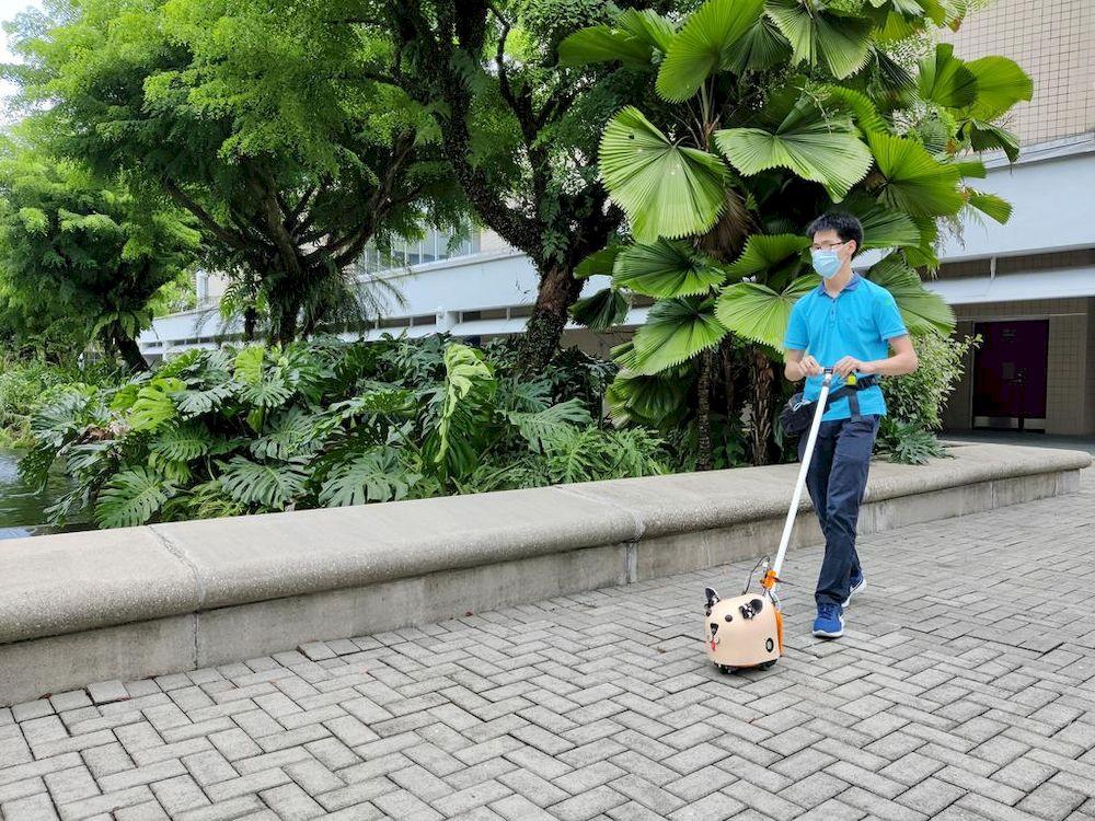 Nanyang Polytechnic student Dallon Au demonstrating the e-Guide Dog. — Nanyang Polytechnic pic via TODAY