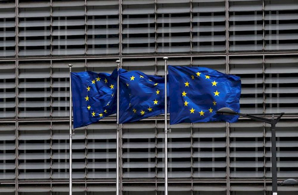European Union flags flutter outside the EU Commission headquarters in Brussels May 5, 2021. — Reuters pic