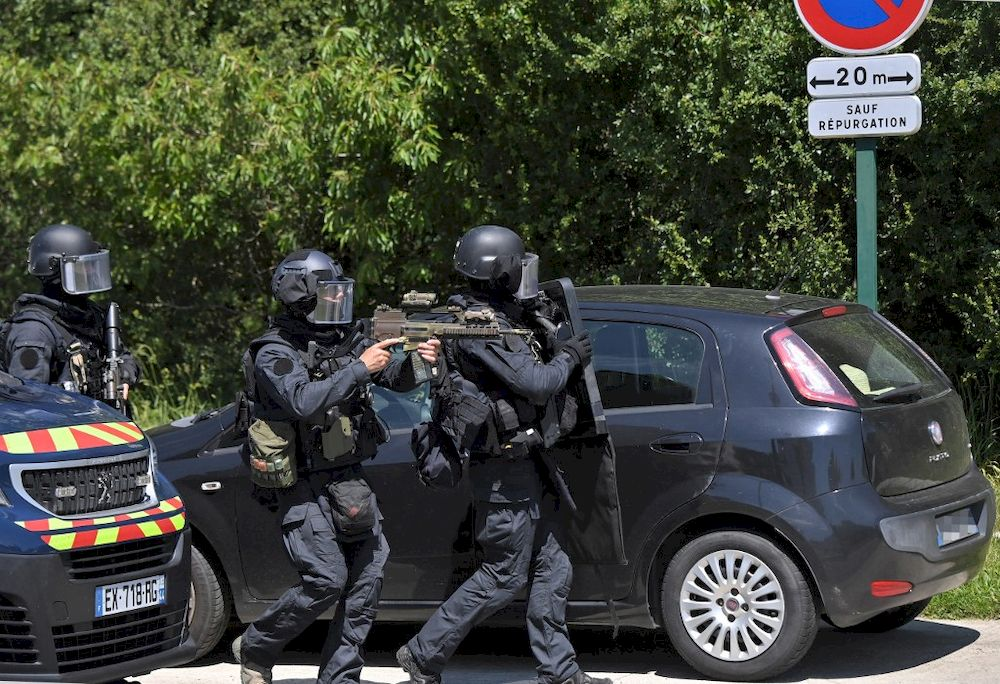 Members of the National Gendarmerie Intervention Group (GIGN) are seen after a municipal policewoman was attacked with a knife on May 28, 2021, in La Chapelle-sur-Erdre, near Nantes, France. — AFP pic