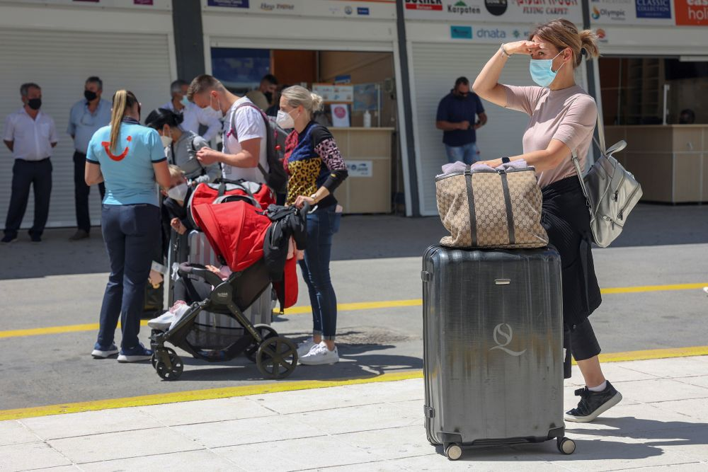 A woman wearing a protective face mask stands with to her luggage as passengers from Germany and Switzerland arrive at the Heraklion airport, during the country's official tourism season opening, on the island of Crete May 15, 2021. — Reuters pic