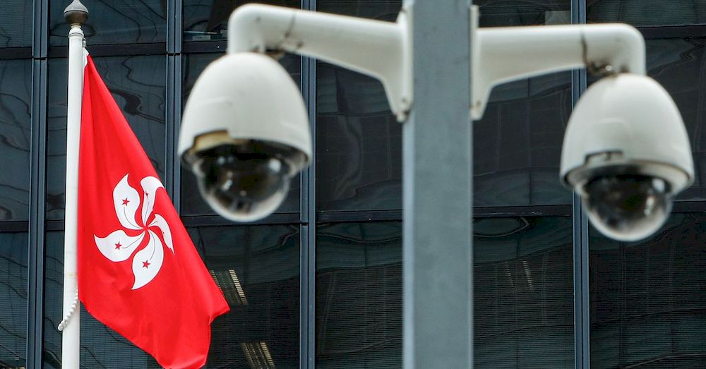 A Hong Kong flag is flown behind a pair of surveillance cameras outside the Central Government Offices in Hong Kong, China July 20, 2020. — Reuters pic