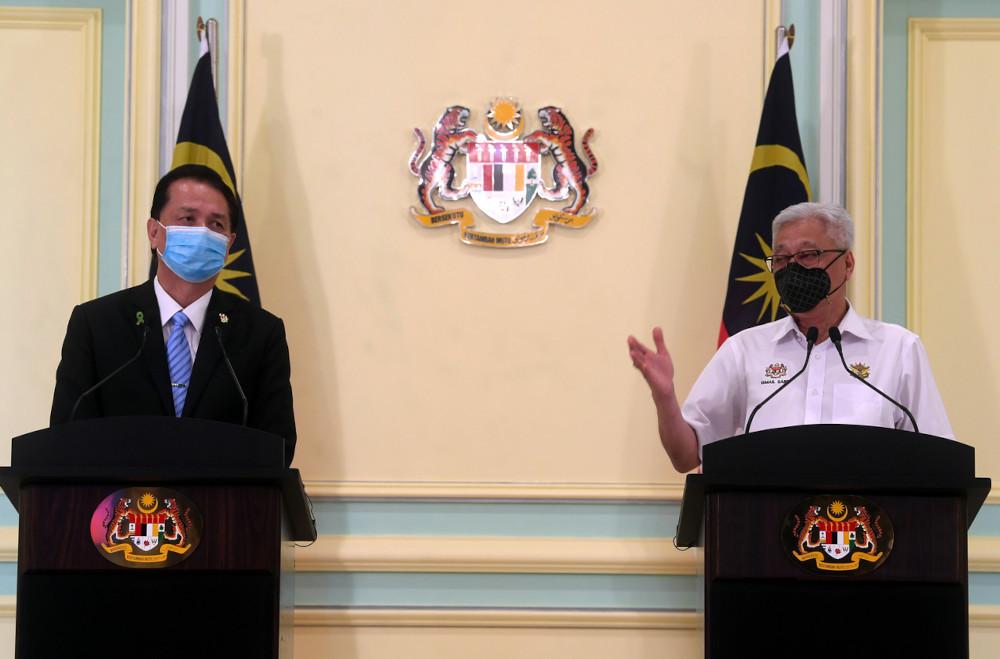 Senior Minister (Security Cluster) Datuk Seri Ismail Sabri Yaakob and Health director-general Tan Sri Dr Noor Hisham Abdullah during a joint press conference at the Perdana Putra building in Putrajaya, May 11, 2021. — Bernama pic