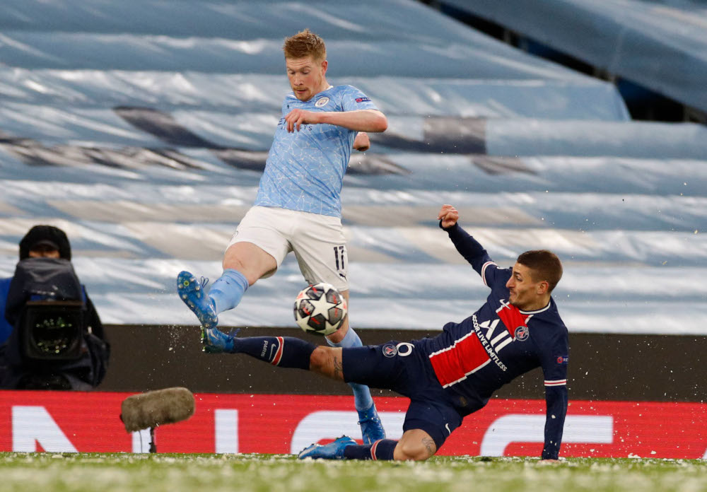Manchester City's Kevin De Bruyne in action with Paris St Germain's Marco Verratti at Etihad Stadium, Manchester, Britain, May 4, 2021. — Reuters pic