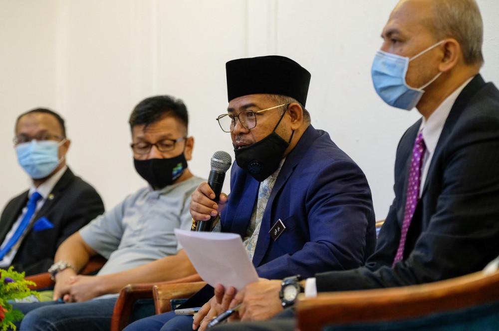 Datuk Mohd Khairuddin Aman Razali speaks to reporters after attending a dialogue session under the Jerayawara Malaysian Timber Council (MTC) 2021 roadshow in Melaka, May 6, 2021. — Bernama pic