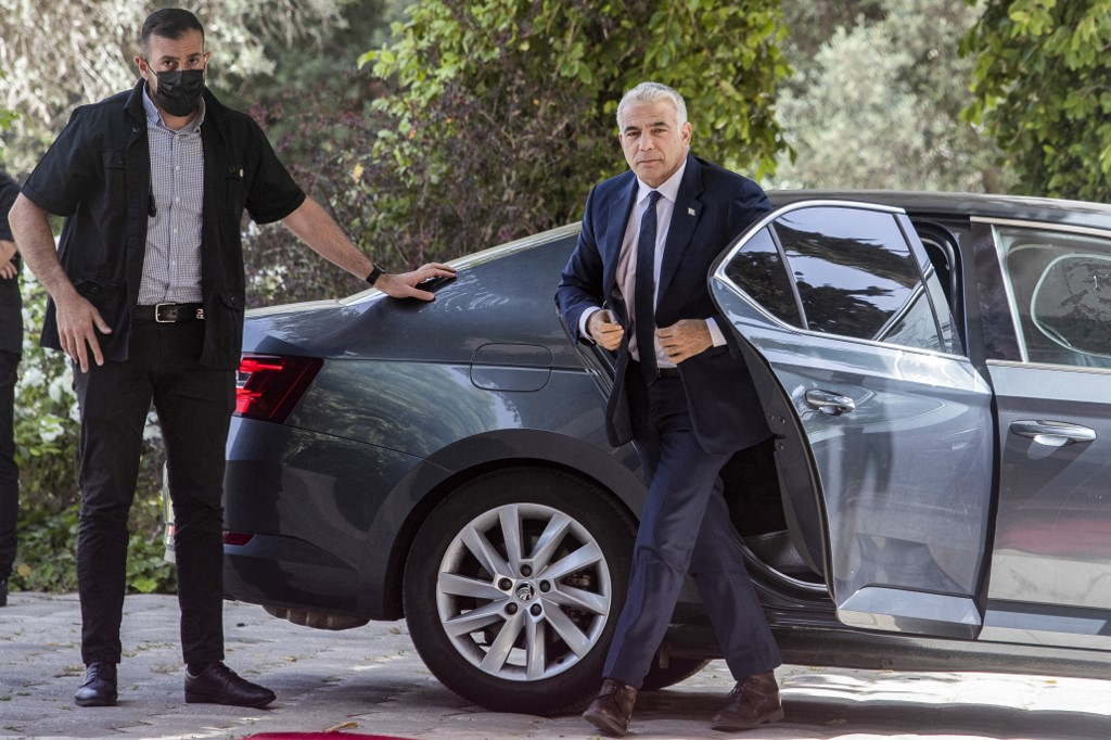 Yair Lapid, leader of the Yesh Atid (There Is a Future) party, arrives at the Israeli President's residence in Jerusalem on May 5, 2021. — AFP pic