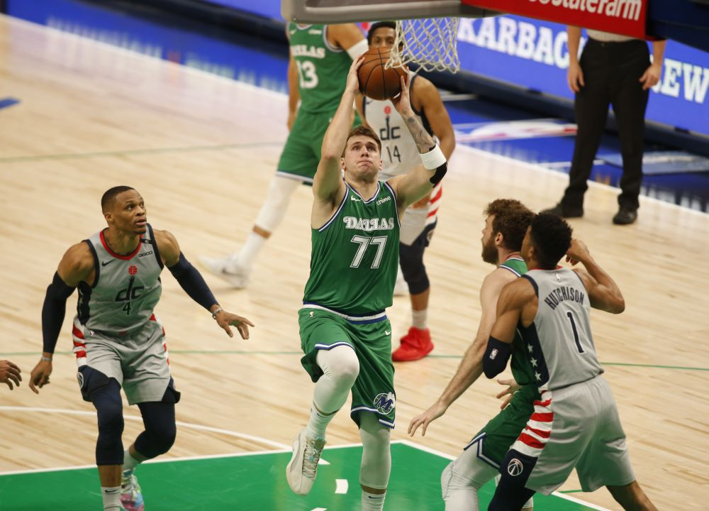 Dallas Mavericks guard Luka Doncic (77) drives against the Washington Wizards during the first quarter at American Airlines Centre May 1, 2021. — Reuters pic