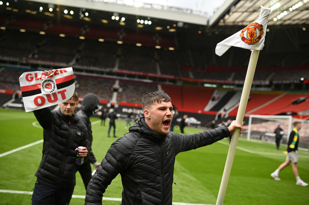 Supporters protest against Manchester United's owners, inside the Old Trafford stadium in Manchester, north-west England May 2, 2021, ahead of their English Premier League fixture against Liverpool. — AFP pic