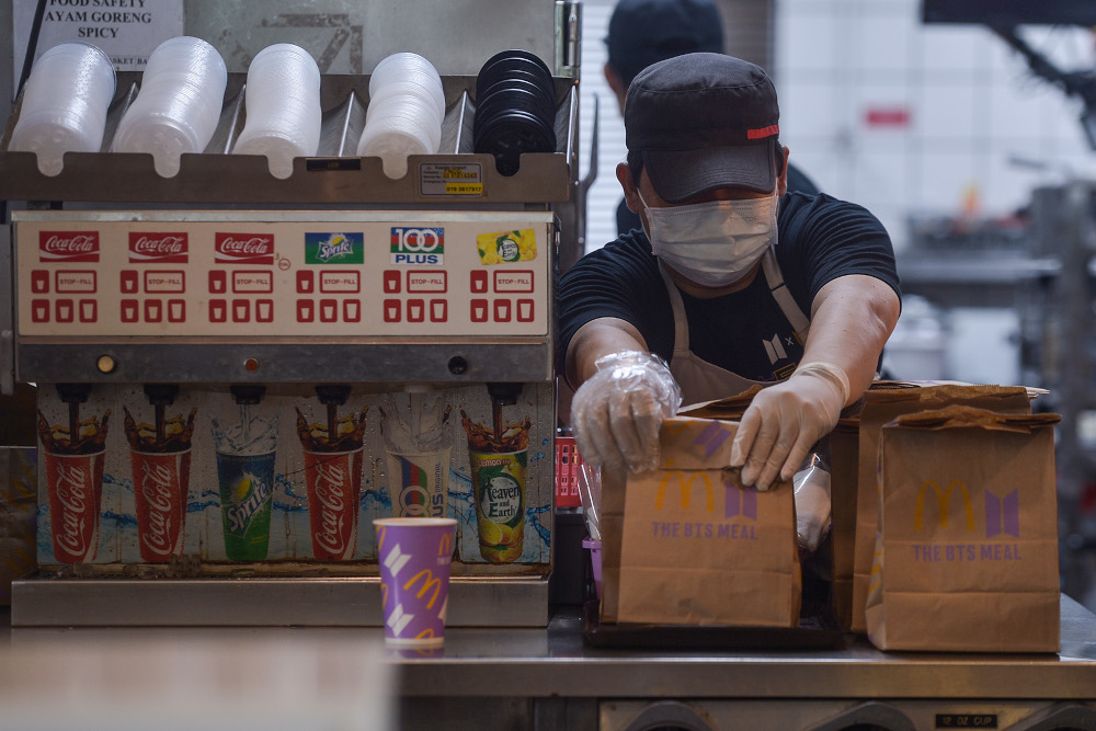 McDonald's staff prepare BTS Meals at the fast food outlet in Seksyen 3, Shah Alam May 26, 2021. — Picture by Miera Zulyana
