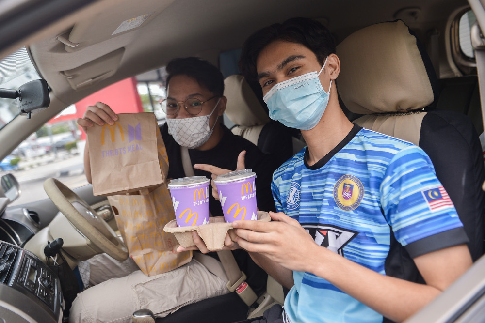 Happy customers with their BTS Meals at the McDonald's outlet in Seksyen 3, Shah Alam May 26, 2021. — Picture by Miera Zulyana