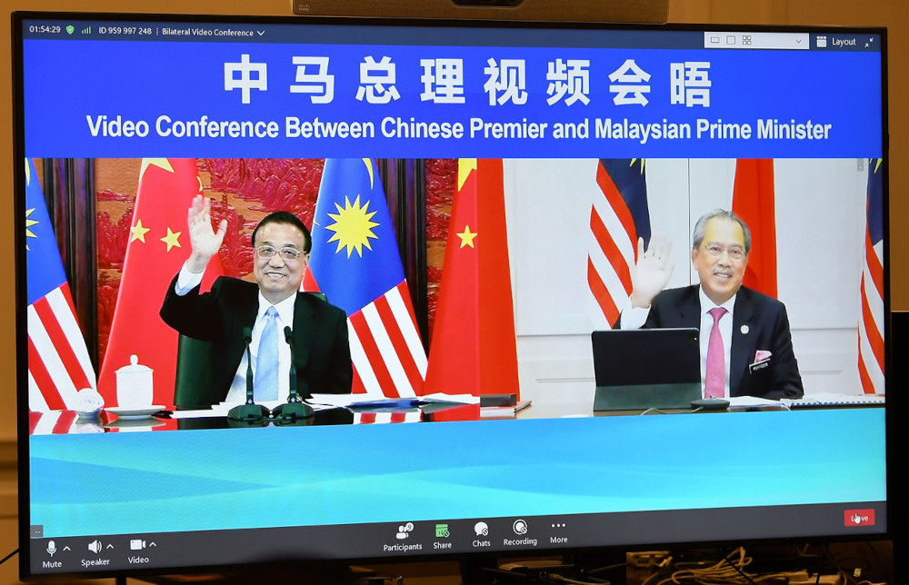 Prime Minister Tan Sri Muhyiddin Yassin during a video call with the People's Republic of China Prime Minister Li Keqiang, May 21, 2021. — Bernama pic