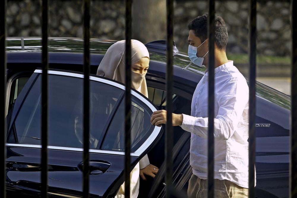 Noor Neelofa Mohd Noor and her husband Muhammad Haris Mohd Ismail arrive at the Seremban Magistrate's Court May 20, 2021. — Bernama pic