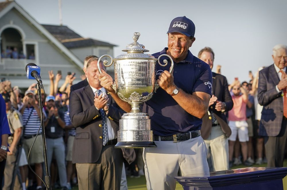 Phil Mickelson raises the Wanamaker Trophy after winning the PGA Championship golf tournament in South Carolina May 23, 2021. — Reuters pic
