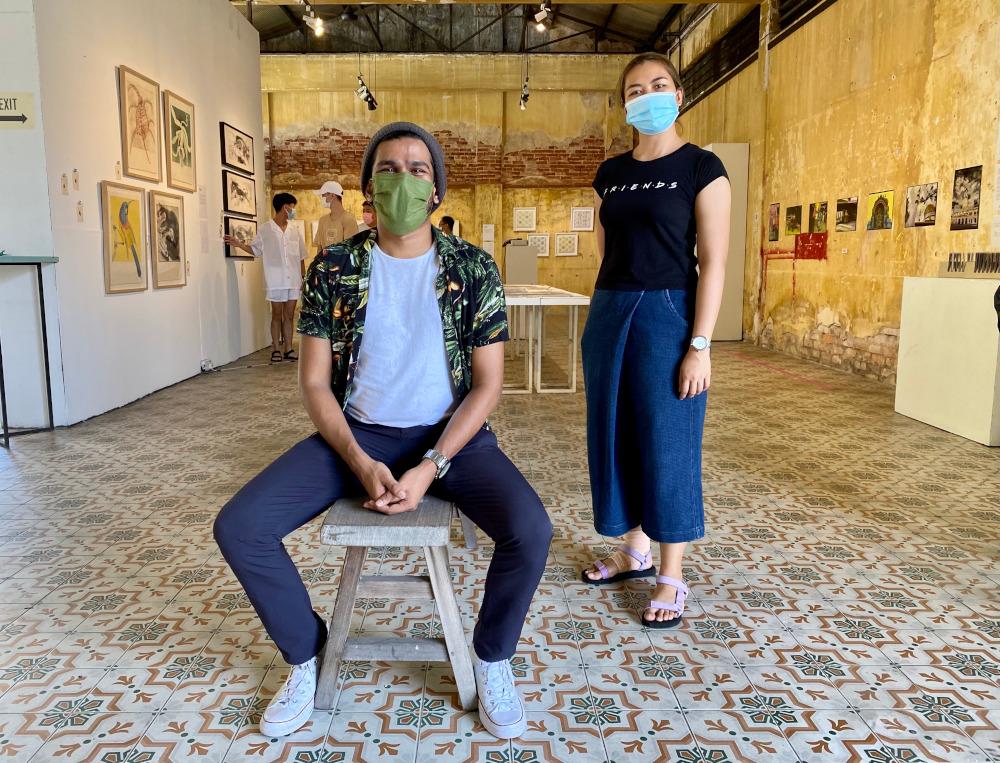 REKA curators Ivan Gabriel and Wanda Razali at the exhibition.