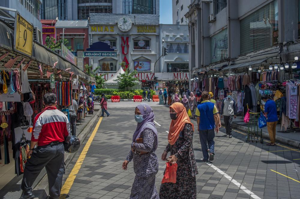 People wearing face masks throng Jalan Tuanku Abdul Rahman to do some shopping in Kuala Lumpur May 10, 2021. — Picture by Shafwan Zaidon