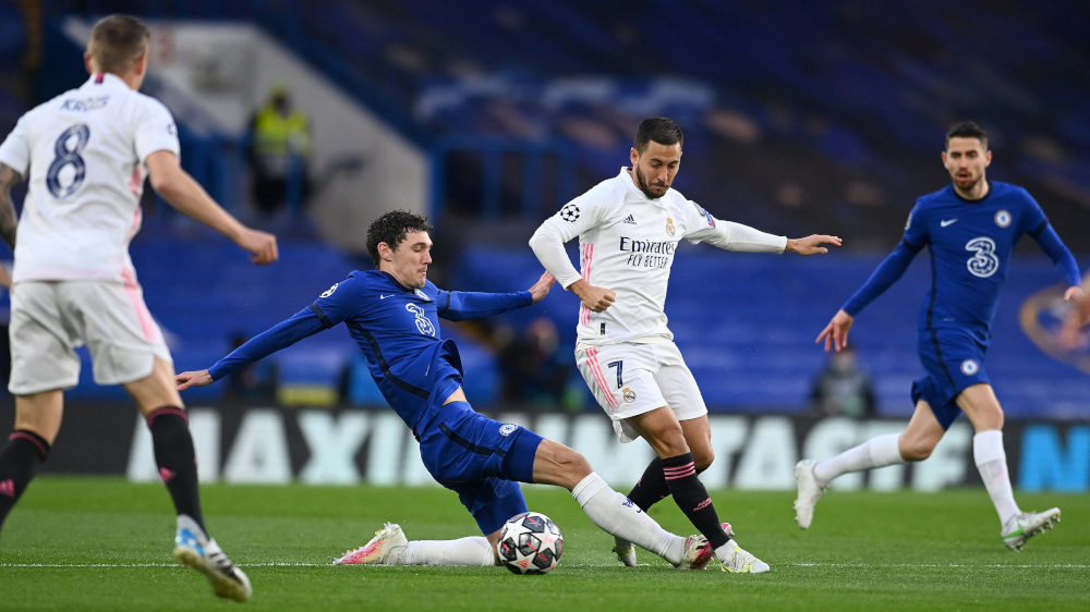 Chelsea's Danish defender Andreas Christensen vies with Real Madrid's Belgian forward Eden Hazard during the Uefa Champions League second leg semi-final football match between Chelsea and Real Madrid at Stamford Bridge in London May 5, 2021. — AFP pic