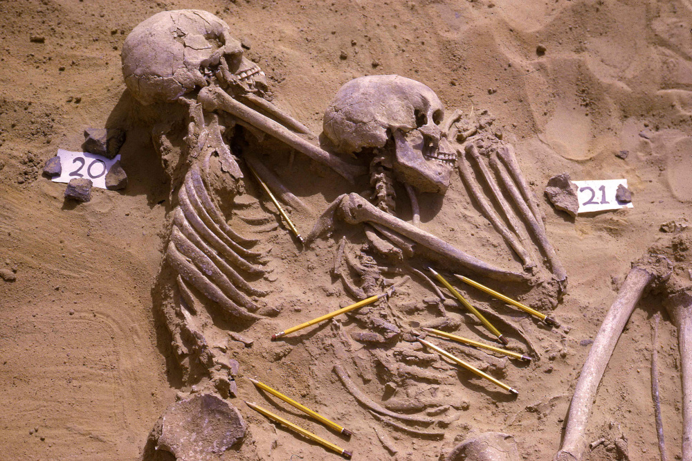 The double burial of individuals identified as JS 20 and JS 21 from among the 13,400-year-old Jebel Sahaba remains from Sudan, some of the earliest evidence of human warfare, with pencils marking the position of associated stone artefacts. — Wendorf Archives of the British Museum handout pic via Reuters