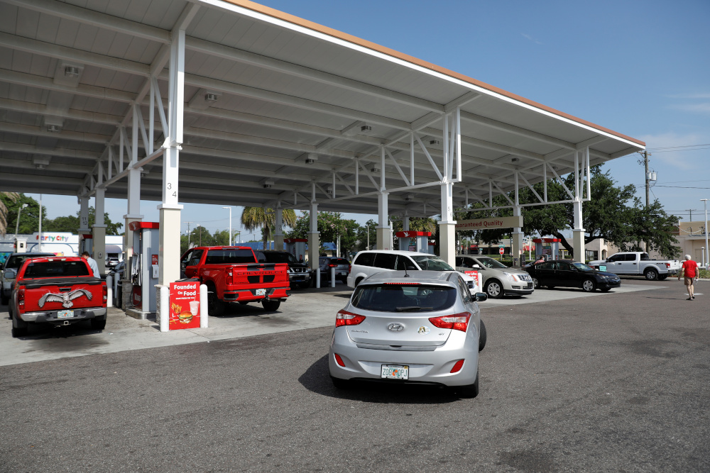 Vehicles refuel at a Wawa gas station, after a cyberattack crippled the biggest fuel pipeline in the country, run by Colonial Pipeline, in Tampa, Florida May 12, 2021. — Reuters pic