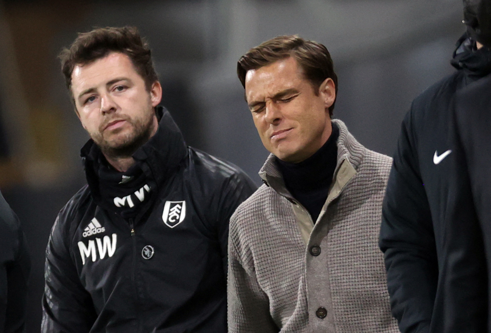Fulham's English manager Scott Parker (right) reacts during the English Premier League football match between Fulham and Burnley at Craven Cottage in London May 10, 2021. — AFP pic