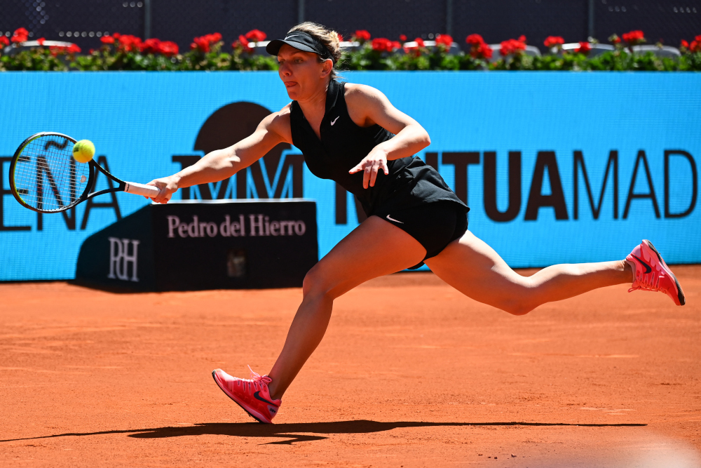 Romania's Simona Halep returns the ball to Belgium's Elise Mertens during their 2021 WTA Tour Madrid Open tennis tournament singles match at the Caja Magica in Madrid May 4, 2021. — AFP pic