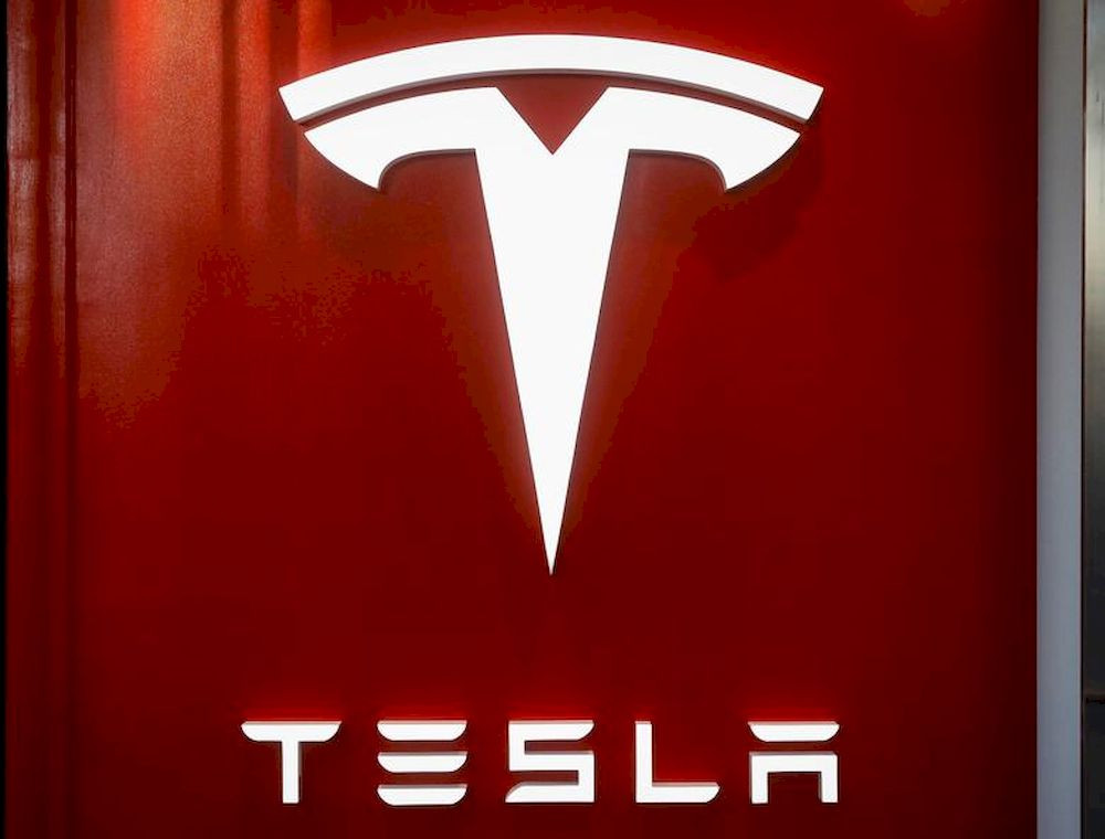 The Tesla logo is seen at the entrance to Tesla Motors' new showroom in Manhattan's Meatpacking District in New York City, US, December 14, 2017. — Reuters pic