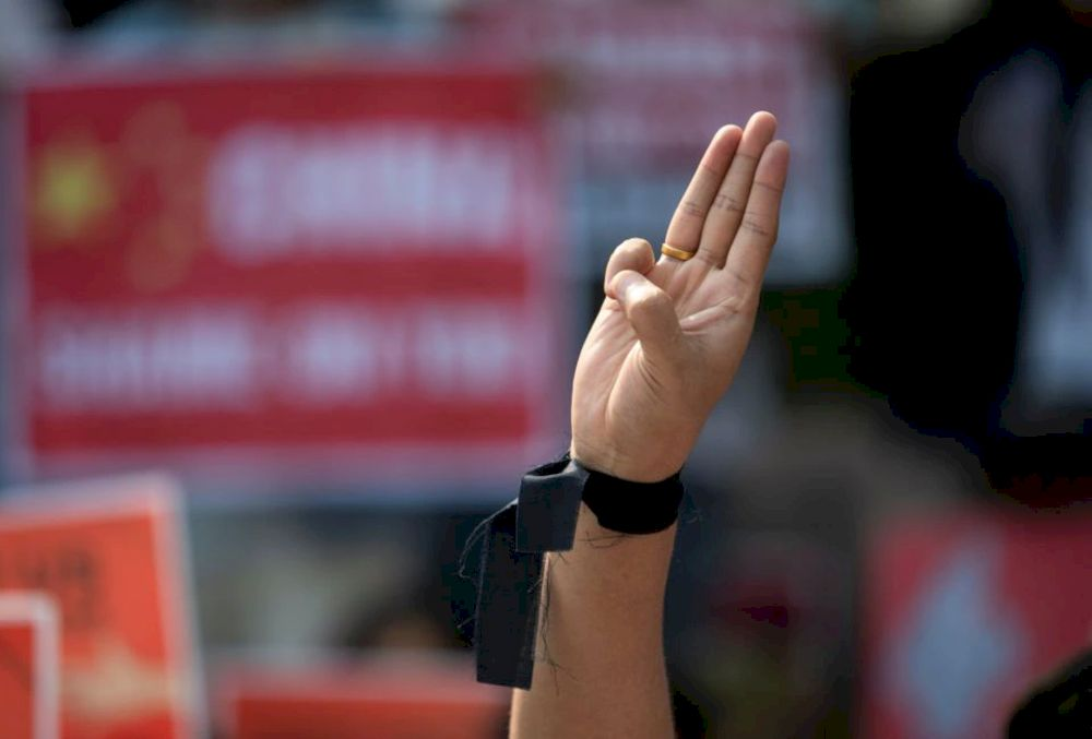A demonstrator shows the three-finger salute during a protest against the military coup in Yangon, Myanmar, February 21, 2021. — Reuters pic