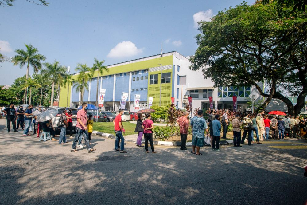 People queuing up to receive the Covid-19 vaccine at Stadium Titiwangsa Kuala Lumpur May 25, 2021. ― Picture by Firdaus Latif