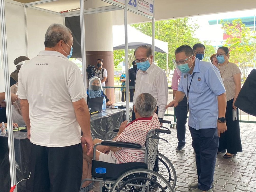 Deputy Chief Minister Datuk Amar Douglas Uggah visits the Covid-19 vaccination centre at the Sarawak Indoor Stadium in Kuching May 20, 2021. — Picture courtesy of the Sarawak Public Communication Unit (Ukas)