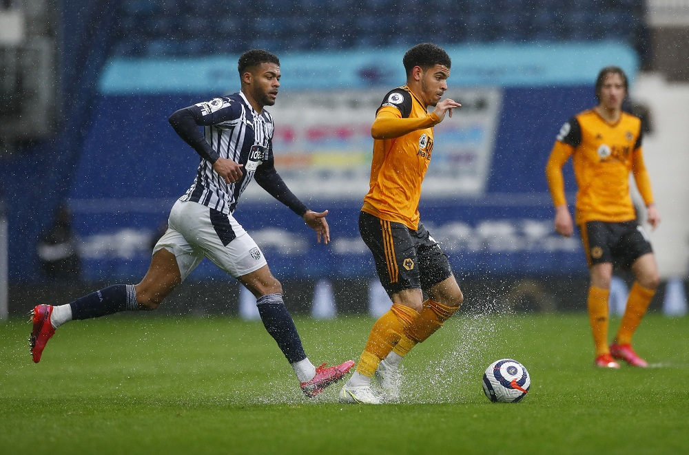 West Bromwich Albion's Darnell Furlong in action with Wolverhampton Wanderers' Morgan Gibbs-White, May 4, 2021. ― Pool via Reuters