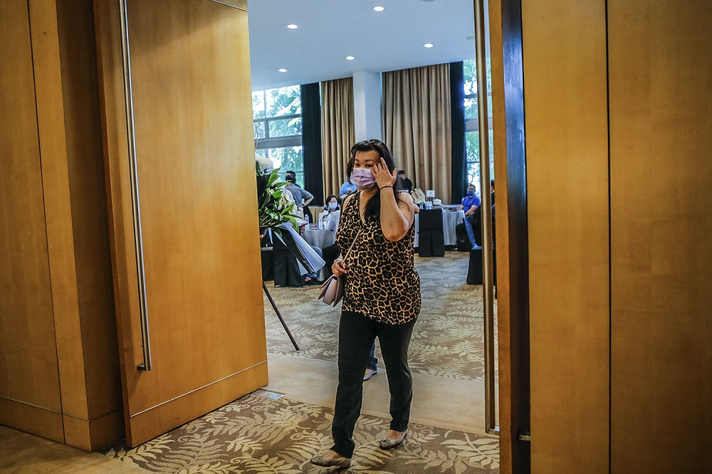 The Star's chief content officer, Esther Ng, arrives to pay her last respects to Datuk Wong Sai Wan during his wake service at the Xiao En centre in Kuala Lumpur May 15, 2021. ― Picture by Hari Anggara