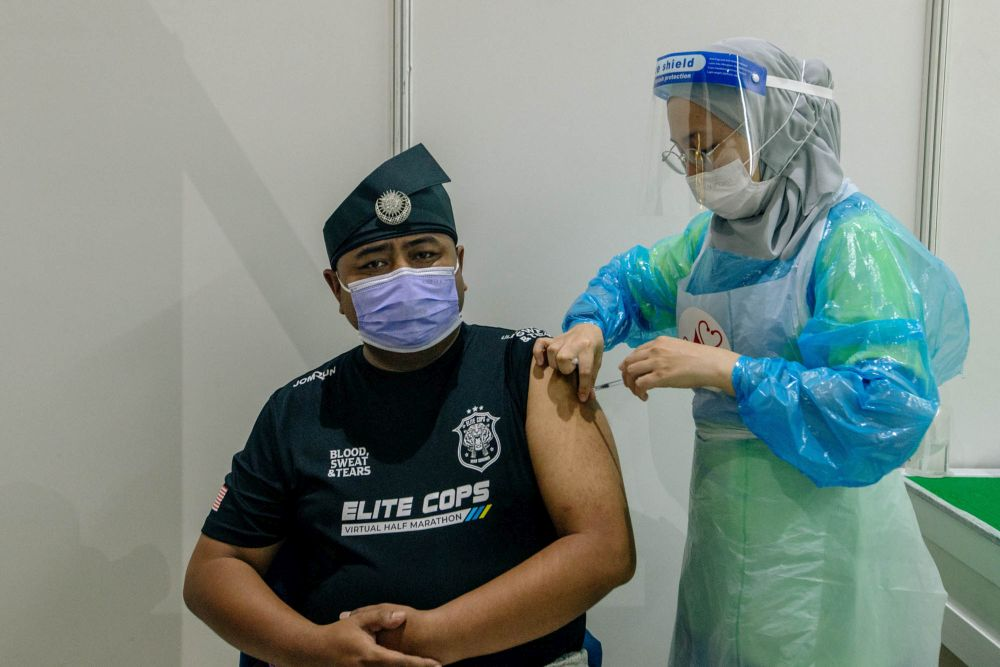 A nurse administers a dose of the AstraZeneca Covid-19 vaccine at the World Trade Centre Kuala Lumpur vaccination centre May 16, 2021. — Picture by Firdaus Latif