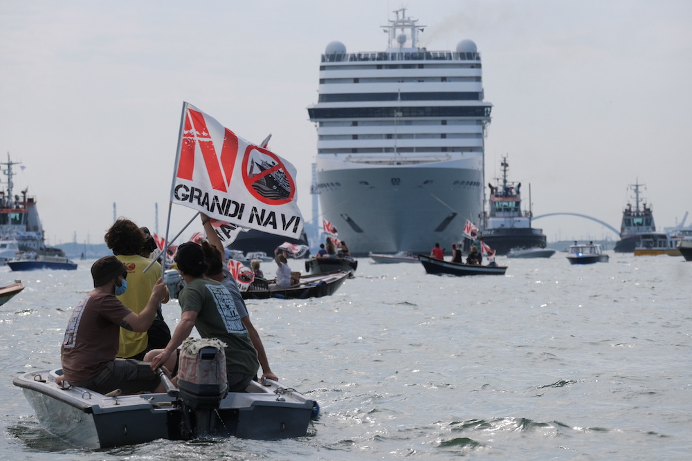 Venice residents sit on boats as they protest to demand an end to cruise ships passing through the lagoon city, as the first cruise ship of the summer season departs from the Port of Venice, Italy June 5, 2021. — Reuters pic