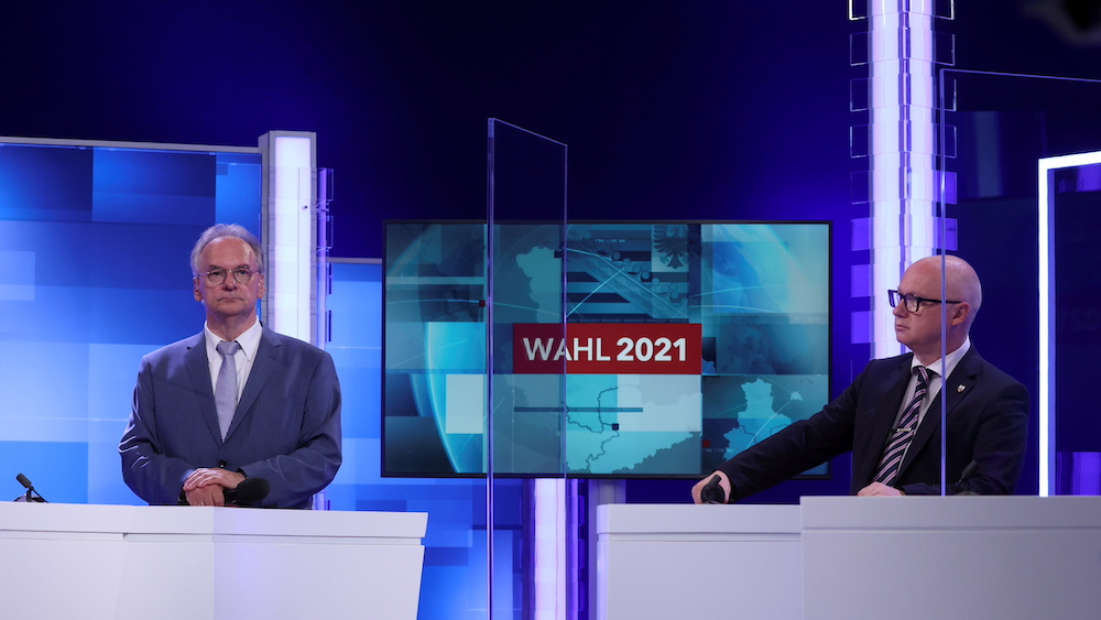 Far-right Alternative for Germany (AfD) main candidate Oliver Kirchner (right) and Reiner Haseloff, top candidate of his conservative CDU party, attend a televised debate in Magdeburg, Germany June 6, 2021. — Ronny Hartmann/Pool via Reuters