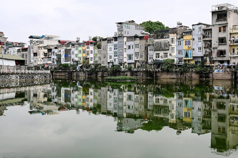 This photograph taken on June 8, 2021 shows narrow residential houses, known as 'nha ong' in Vietnamese or 'tube houses', in an urban area of Hanoi. — AFP pic