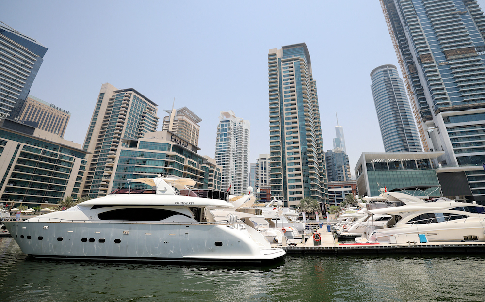 Luxury yachts are moored at the Dubai Marina Beach in the Gulf emirate, on June 10 2021. — AFP pic