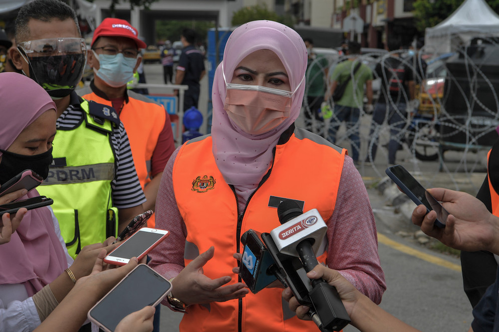 Datuk Seri Rina Harun speaks to reporters after handing out food basket contributions at the Desa Rejang People's Housing Project, June 20, 2021. — Bernama pic