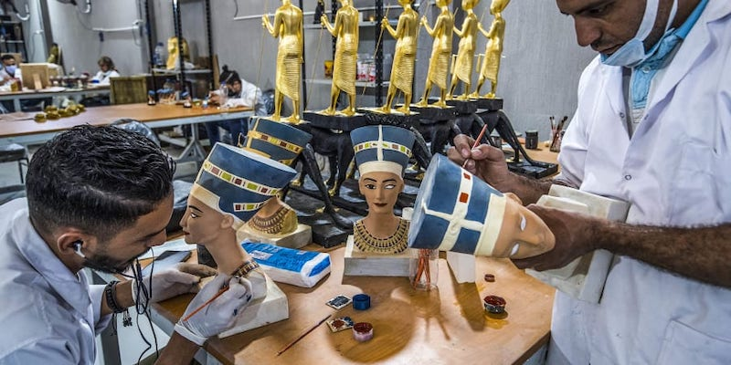 Technicians paint replicas of Ancient Egyptian busts of Queen Nefertiti being fabricated at the Egyptian government's Konouz (Treasures) factory reproducing replicas of Ancient Egyptian items. — AFP pic