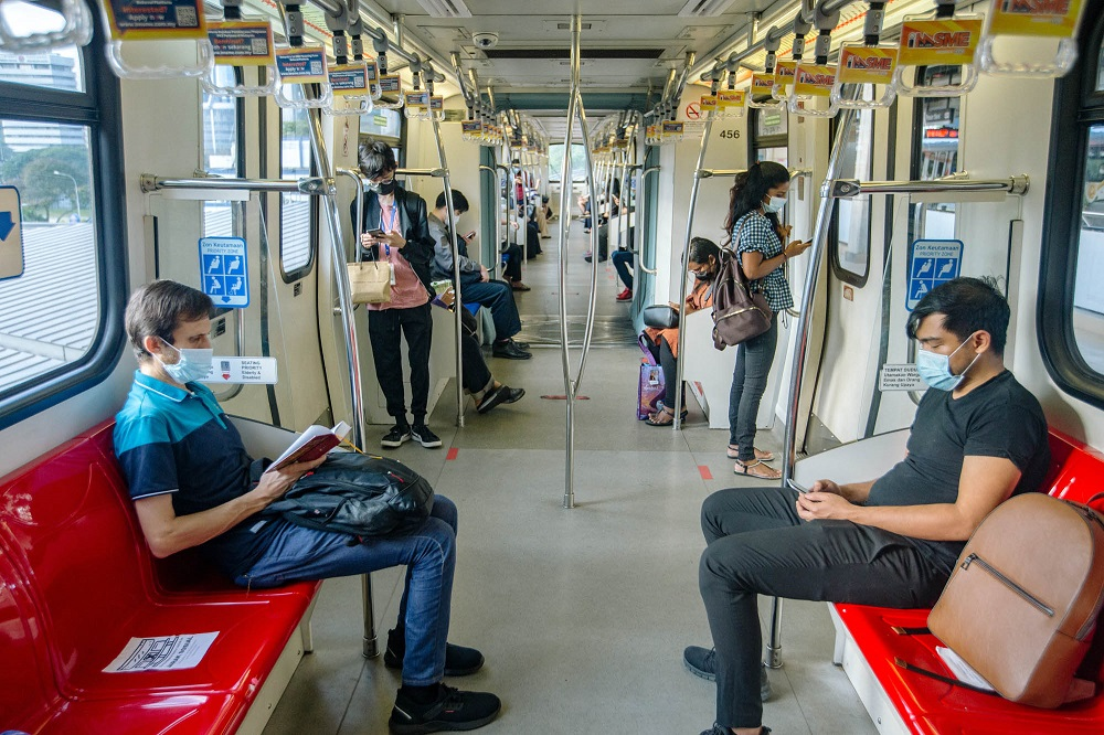 Passengers don face masks during a an LRT ride in Kuala Lumpur June 1, 2021. — Picture by Firdaus Latif