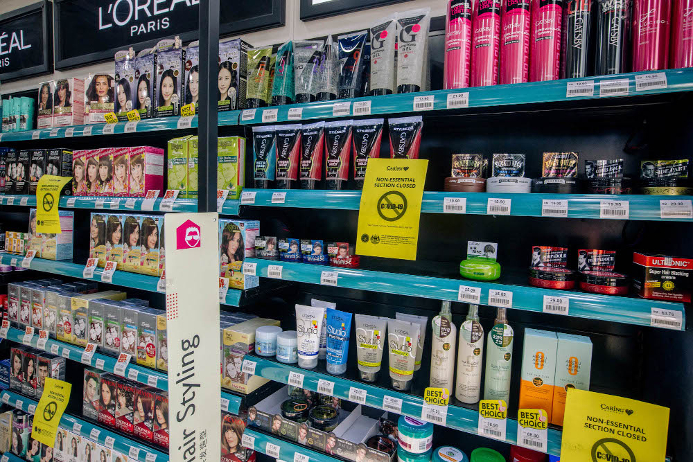 A section of a Caring drugstore can be seen in Kuala Lumpur on June 4, 2021. Non-essential sections that sell hair dye, sun care, face masks and hair gel for men are closed due to the control order complete movements (OCAF).  - Photo by Firdaus Latif