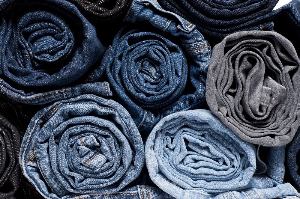 A pair of jeans can travel up to 65,000 km before arriving in your closet. — ETX Studio pic