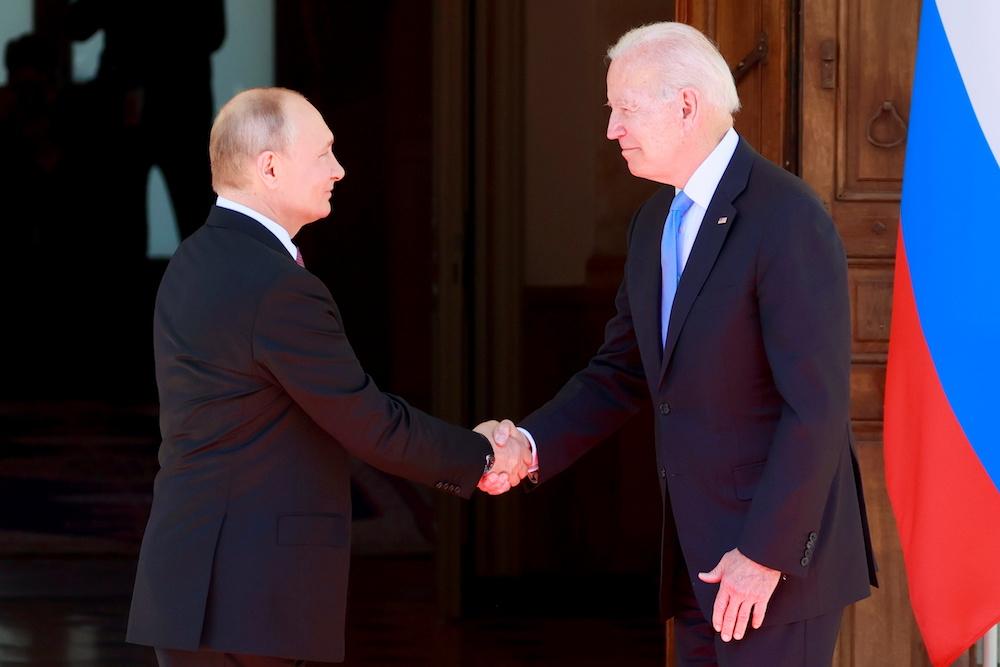 US President Joe Biden and Russia's President Vladimir Putin shake hands during the US-Russia summit at Villa La Grange in Geneva, Switzerland, June 16, 2021. — Reuters pic