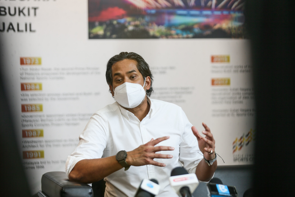 Minister of Science Technology and Innovation Khairy Jamaluddin speaks to the media at the Covid-19 vaccination centre in Bukit Jalil June 21, 2021. — Picture by Ahmad Zamzahuri