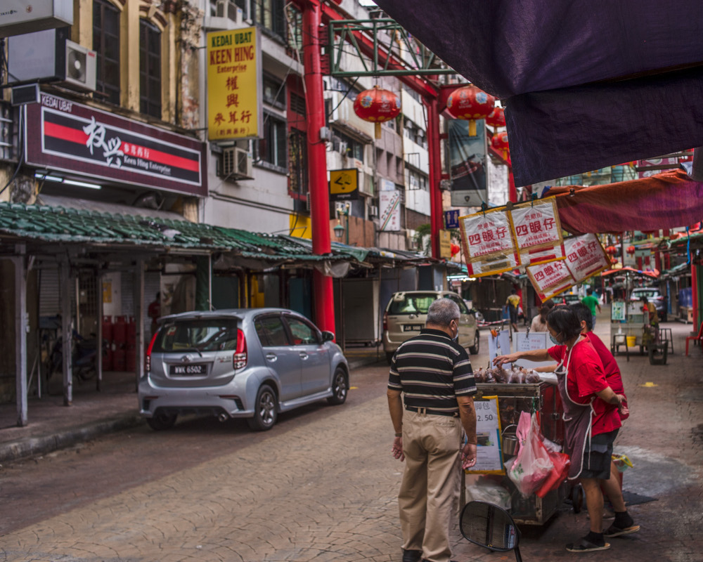 Petaling Street is mostly quiet except nearer towards the middle. Seen here is the Sze Ngan Chye stall, with the Madam Tang Muah Chee Queen stall in the backdrop also open. — Picture by Shafwan Zaidon