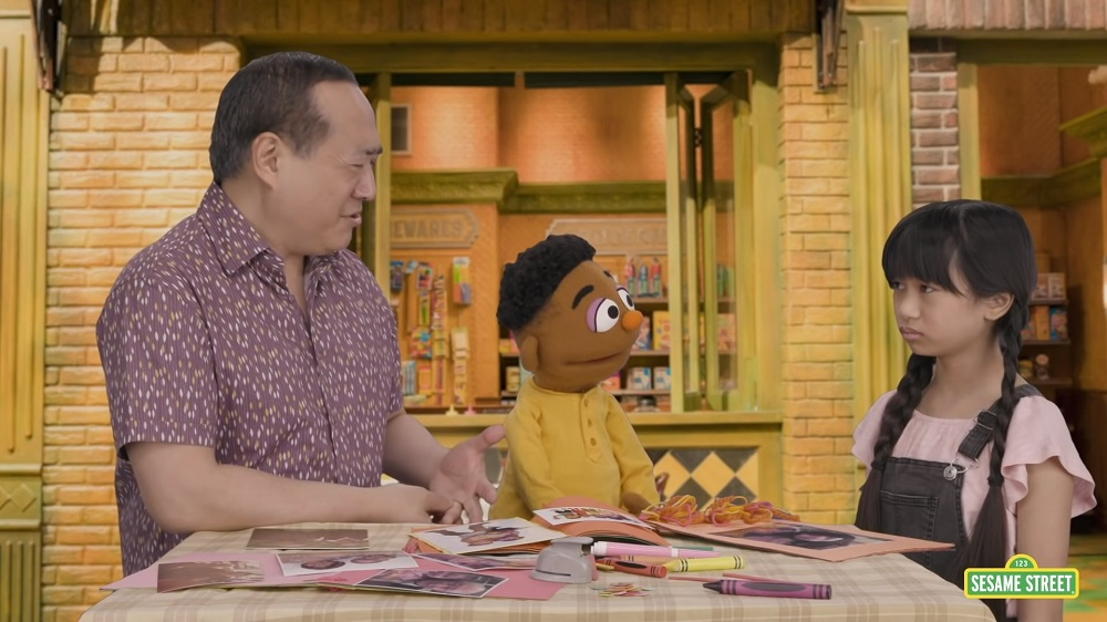 The video focuses on Analyn (right) who is upset after a boy at the park makes fun of her eyes. — Screengrab from YouTube/Sesame Street