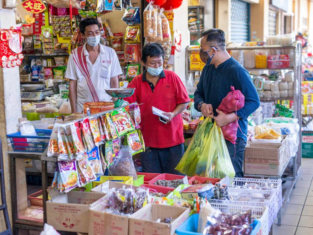 Sim took Ah Soon to buy ingredients to prep for his new stall's opening this evening. —Picture from Facebook/Steven Sim