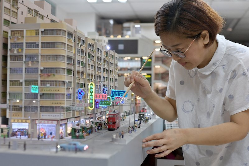 This photo taken on June 23, 2021 shows model maker Maggie Chan of Toma Miniatures working at her studio in Hong Kong. — AFP pic