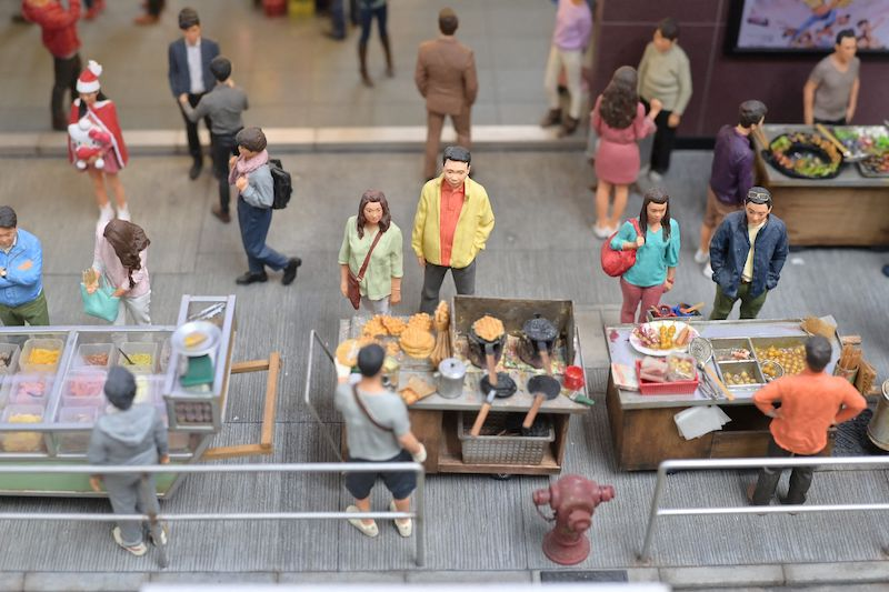 This photo taken on June 23, 2021 shows a recreation of a scene from old Hong Kong, created by model makers Maggie Chan and Tony Lai of Toma Miniatures, pictured at their studio in Hong Kong. — AFP pic