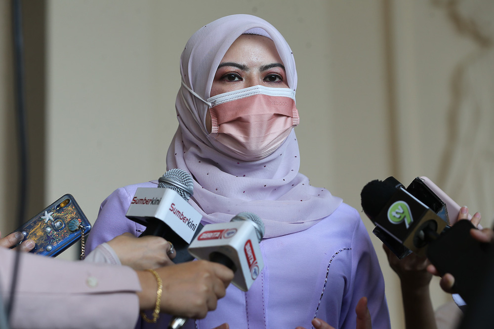 Woman, Family and Community Development Minister Datuk Seri Rina Mohd Harun speaks to the media at the vaccination centre at Sunway Pyramid Convention Centre in Petaling Jaya June 27, 2021. — Picture by Yusof Mat Isa