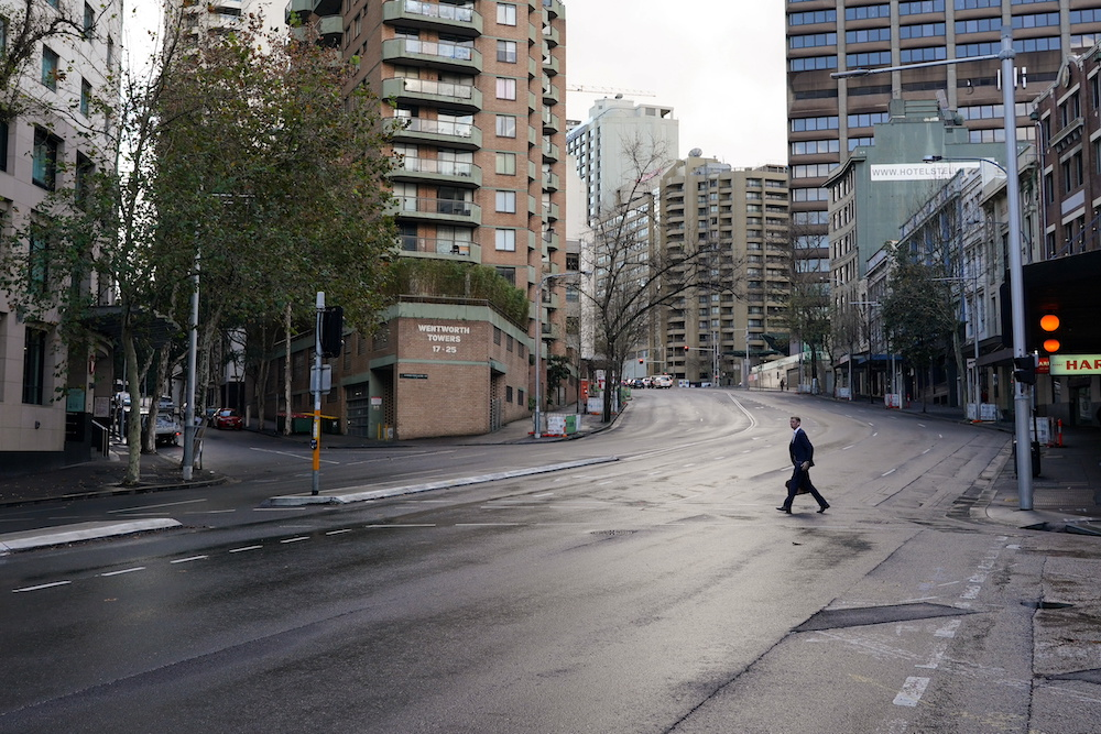 A pedestrian crosses an empty intersection at morning commute hour in the city centre during a lockdown to curb the spread of Covid-19 in Sydney, Australia, June 28, 2021. — Reuters pic